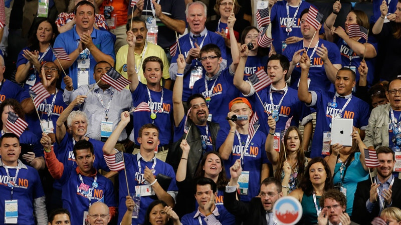 Delegates cheer during Rep. Jared Polis of Colorado's speech at the Democratic National Convention in Charlotte, N.C., on Tuesday, Sept. 4, 2012. (AP / Lynne Sladky)