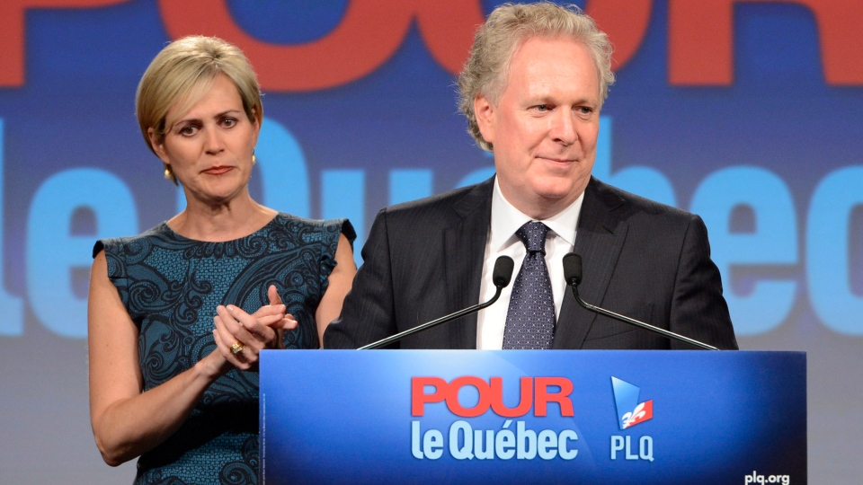 Quebec Liberal party leader Jean Charest speaks while his wife Michele Dionne looks on following the provincial election in Sherbrooke, Que., on Tuesday, Sept. 4, 2012. (Ryan Remiorz / THE CANADIAN PRESS)