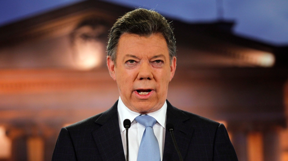 Colombia's President Juan Manuel Santos delivers a speech during a televised address to the nation at the presidential palace in Bogota, Colombia, Monday, Aug. 27, 2012. Santos said his government has held exploratory talks with rebels of the the leftist Revolutionary Armed Forces of Colombia, FARC. (AP/Fernando Vergara)
