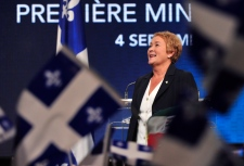 Parti Quebecois Leader Pauline Marois takes the stage after winning