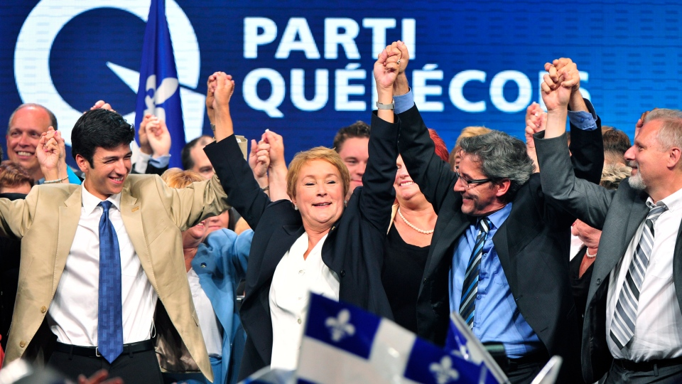 Parti Quebecois Leader Pauline Marois returns to complete her speech after being whisked off the stage by security as she delivered her victory speech in Montreal, Que., Tuesday, Sept. 4, 2012. (Paul Chiasson / THE CANADIAN PRESS)