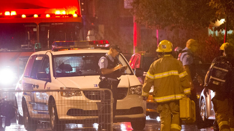 Police cordon off the rear outside an auditorium where a gunman shot and killed at least one person during the PQ victory rally in Montreal, Wednesday, Sept. 5, 2012. (Paul Chiasson / THE CANADIAN PRESS)