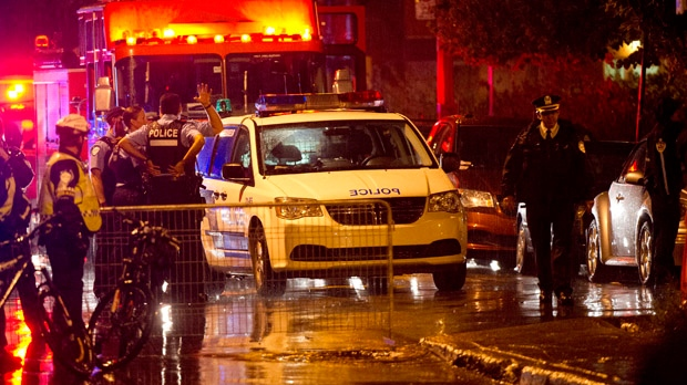 Police cordon off an auditorium where a gunman shot and killed one person during the PQ victory rally in Montreal early Wednesday, Sept. 5, 2012. (Paul Chiasson / THE CANADIAN PRESS)