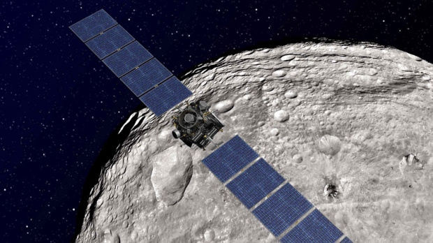 Undated artist rendering shows the NASA Dawn spacecraft in orbit around Vesta.