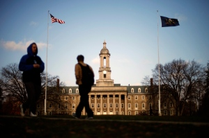 In this Nov. 11, 2011 file photo, students walk past the Old Main building on the Penn State campus in State College, Pa. (AP / Matt Rourke)