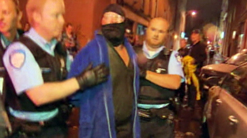 In this image taken from video courtesy Radio Canada, a man is taken into custody following the shooting at PQ headquarters in Montreal, late Tuesday, Sept. 4, 2012.