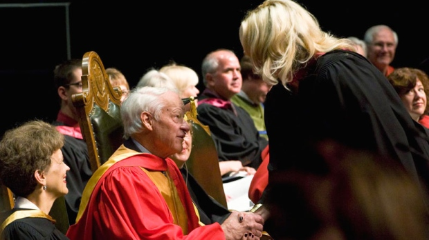 NHL legend Gordie Howe shakes hands with a recent graduate during graduation ceremonies at TCU Place in Saskatoon, on Thursday, June 3, 2010. (Liam Richards / THE CANADIAN PRESS)