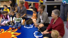 Education Minister Margaret MacDiarmid, far right, joins a kindergarten class for the first day of school. Sept. 7, 2010. (CTV)