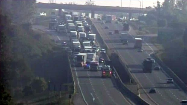 Traffic is seen backed up after two crashes on Highway 401 in Waterloo Region, Ont. on Wednesday, Sept. 5, 2012.