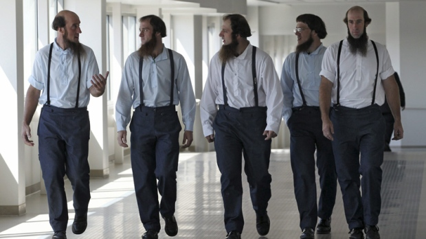 Members of the Amish leave the U.S. Federal Courthouse Tuesday, Aug. 28, 2012, in Cleveland.