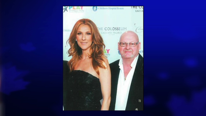 Shooting suspect Richard Henry Bain poses with Celine Dion after winning an auction bid to meet the singer in Las Vegas on Jan. 15, 2012. (Courtesy Mont Tremblant L'Information du Nord Article.)