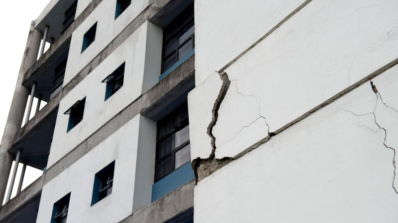 A wall at the University of Costa Rica's school of electrical engineering is damaged after an earthquake in San Jose, Costa Rica, Wednesday, Sept. 5, 2012. (AP / Thomas Dooley)