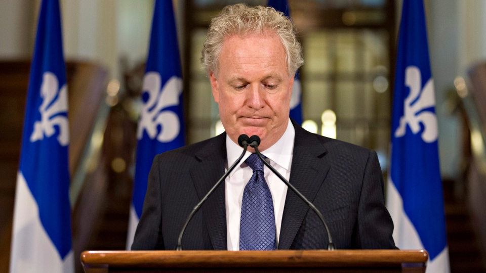 Quebec Liberal Party Leader Jean Charest looks down as he announces his resignation at the Quebec legislature on Wednesday Sept. 5, 2012. (Jacques Boissinot / THE CANADIAN PRESS)