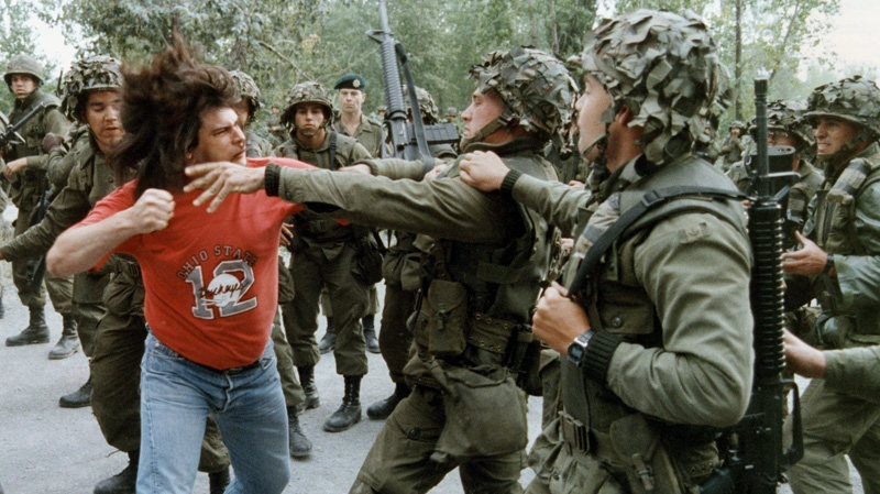 A Mohawk native winds up to punch a soldier during a fight that took place on the Kahnawake reserve on Montreal's south shore, Tuesday, Sept.18, 1990. (Tom Hanson / THE CANADIAN PRESS)