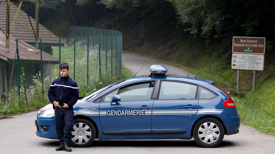 A gendarme blocks access to site where people were shot to death near Chevaline, French Alps, Thursday Sept. 6, 2012. (AP / Laurent Cipriani)