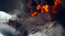 The Deepwater Horizon oil rig is seen burning in this aerial photo taken in the Gulf of Mexico, southeast of Venice, La. on  April 21, 2010. (AP / Gerald Herbert)
