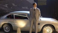 "James Bond and his iconic Aston Martin man the way to the entrance of ""Designing 007: Fifty Years of"