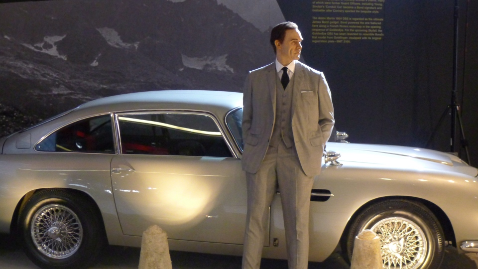 "James Bond and his iconic Aston Martin man the way to the entrance of ""Designing 007: Fifty Years of Bond Style."" (Neil Davidson / THE CANADIAN PRESS)"
