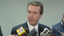 Regina mayoral candidate Michael Fougere speaks to reporters at a news conference Thursday.