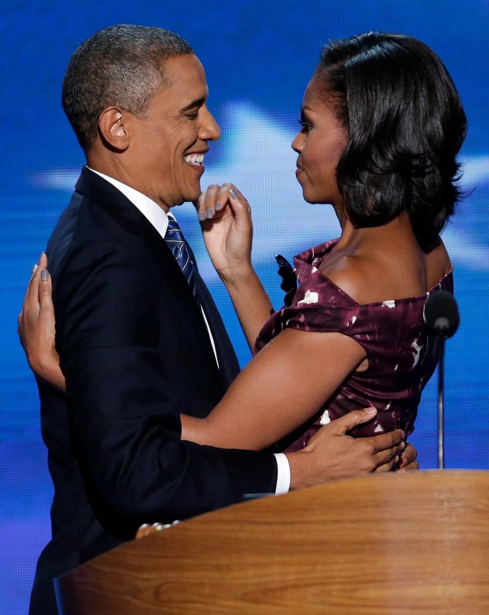 Michelle and Barack Obama share a moment on stage at the Democratic National Convention in Charlotte, N.C., on Thursday, Sept. 6, 2012. (AP / J. Scott Applewhite)