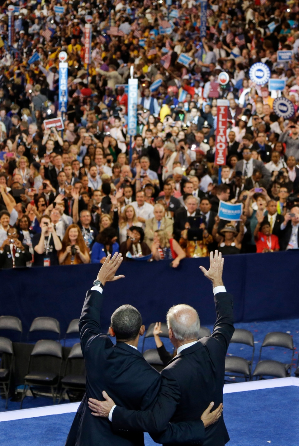 U.S. President Barack Obama and U.S. Vice President Joe Biden wave to delegates at the Democratic National Convention in Charlotte, N.C., on Thursday, Sept. 6, 2012. (AP / Charlie Neibergall)