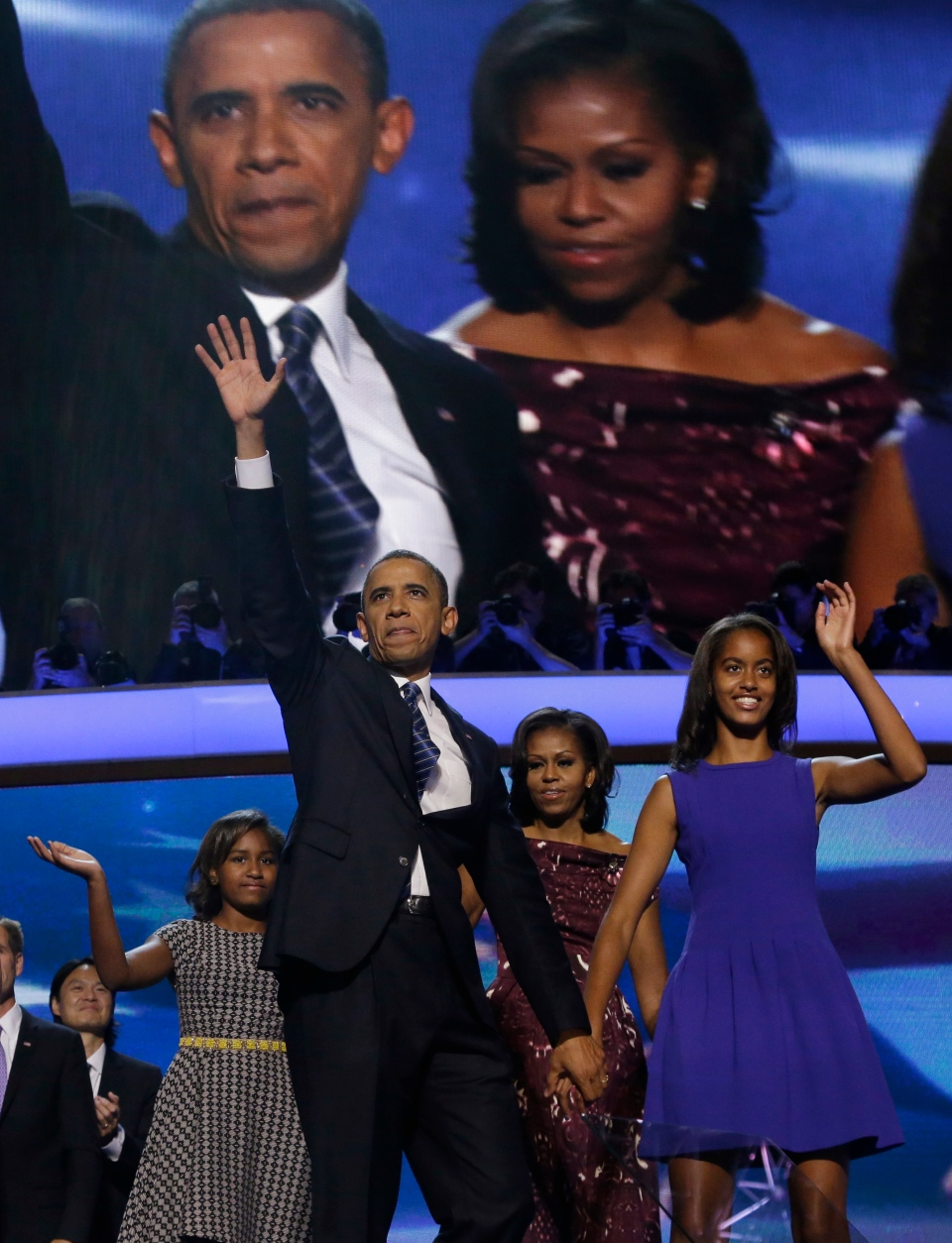 U.S. President Barack Obama and his daughter Malia wave after Obama's speech to the Democratic National Convention in Charlotte, N.C., Thursday, Sept. 6, 2012. Behind them are Sasha and first lady Michelle Obama. (AP / Charles Dharapak)