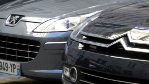 Peugeot, left, and Citroen cars are parked in Paris, Friday, Sept. 7, 2012.  (AP / Jacques Brinon)