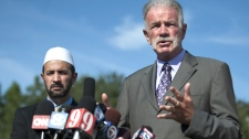 Pastor Terry Jones of the Dove World Outreach Center speaks to the media as Imam Muhammad Musri of the Islamic Society of Central Florida looks on at left in Gainesville, Fla., Thursday, Sept. 9, 2010. (AP / Phil Sandlin)