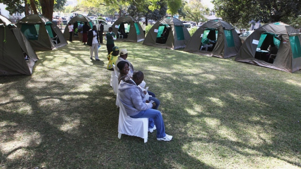 Members of the public wait to be tested for HIV and Aids in Harare, Zimbabwe Friday June, 22, 2012.