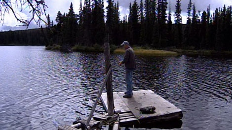 Steve Callander casts a line in B.C.'s Fish Lake, which could be drained to make way for a gold and copper mine. Sept. 9, 2010. (CTV)