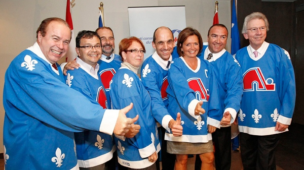 Quebec Conservative MPs wear Quebec Nordique jerseys during a caucus meeting in Quebec City on Wednesday, Sept. 8, 2010. The MPs wore the jerseys to support the construction of a new arena. A march will be held Oct. 2, 2010 in support for the return of the Nordiques. THE CANADIAN PRESS/Le Soleil-Yan Doublet