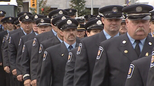 Ottawa Fire Services members march in a parade en route to honour fallen firefighters Friday, Sept. 7, 2012.