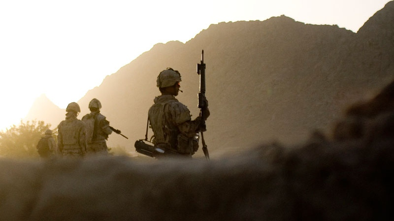 Canadian soldiers with the 1st RCR Battle Group, the Royal Canadian Regiment, patrol in the Panjwaii district near Salavat, southwest of Kandahar, Afghanistan, early Thursday morning, Sept. 9, 2010. (AP / Anja Niedringhaus)