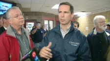 Premier Dalton McGuinty, centre, speaks with some protesters in Lindsay on Thursday, Sept. 9, 2010 who are angry about wind turbines.