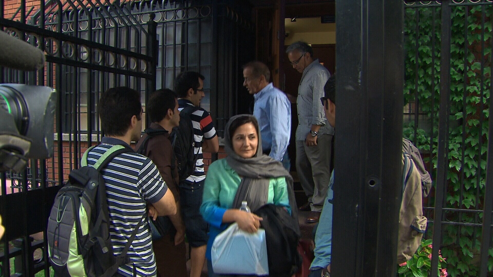 People leave the Iranian embassy in Ottawa on Friday, Sept. 7, 2012, in this photo from video.