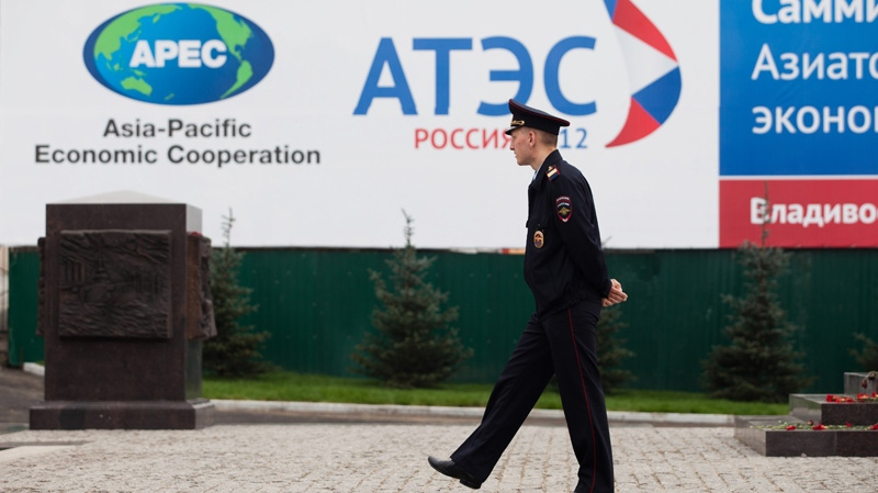 A police officer patrols the central business district of Vladivostok, Russia, Saturday, Sept. 8, 2012. (AP Photo/Alexander Khitrov)