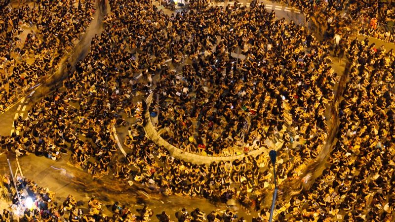Protesters demonstrate outside government headquarters in Hong Kong, Saturday on Sept. 8, 2012. (AP Photo/Kin Cheung)