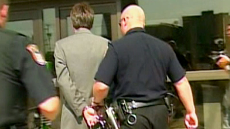 Marc Emery is seen being arrested in 2005 for shipping marijuana seeds to the U.S.