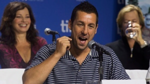 "Adam Sandler, center, flanked by Fran Drescher, left, and David Spade attend a press conference for the new movie ""Hotel Transylvania"" at the 2012 Toronto International Film Festival in Toronto on Saturday, Sept. 8, 2012. (AP Photo/The Canadian Press, Michelle Siu)"
