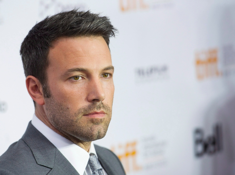 Actor and director Ben Affleck poses for a photograph on the red carpet at the gala for the new movie 'Argo' during the 37th annual Toronto International Film Festival in Toronto on Friday, Sept. 7, 2012. (Nathan Denette / THE CANADIAN PRESS)