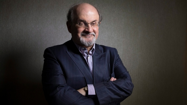 Author Salman Rushdie poses for a photo as he promotes the movie 'Midnight's Children' during the 20