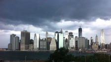 In this photo provided by Gothamist, dark clouds loom over the skyline on Sept. 8, 2012.