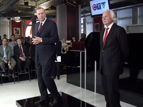 Ivan Fecan, president and CEO of CTVglobemedia, right, and George Cope, president and CEO of Bell Canada Enterprises (BCE), speak to CTV staff during a townhall meeting in Toronto, Friday, Sept. 10, 2010.