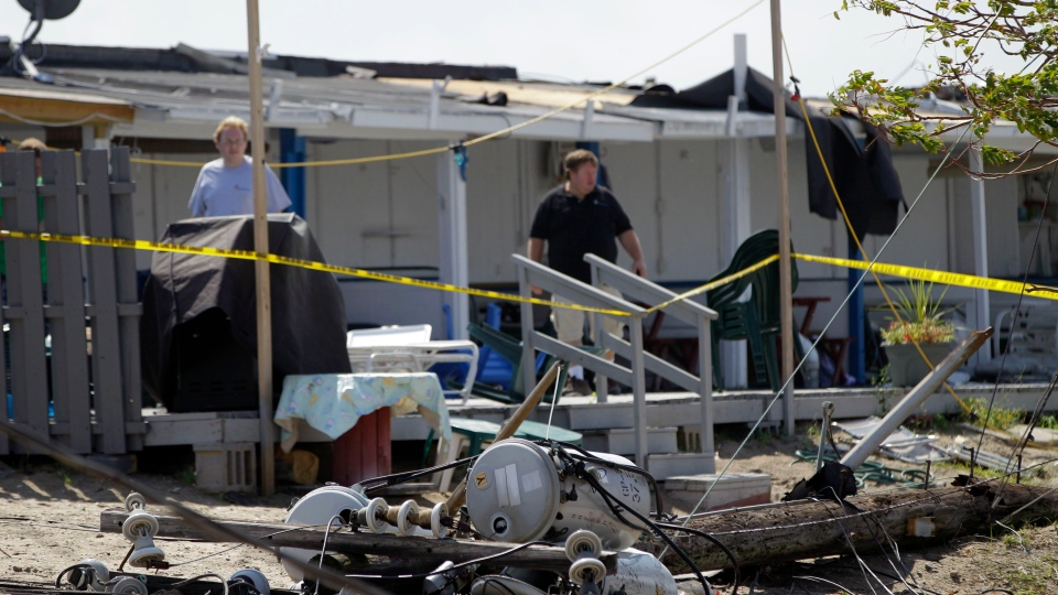 Residents survey damage at the Breezy Point Surf Club after a possible tornado touched down during severe weather in New York, Saturday, Sept. 8, 2012. (AP / Kathy Willens)