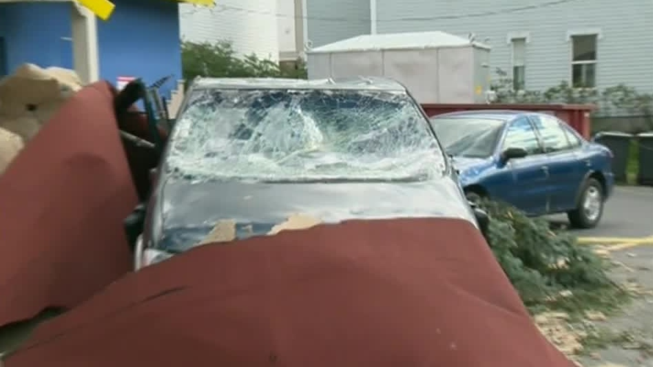 A car is shown after being damaged by a tornado that touched down in Drummondville, Que. on Sunday, Sept. 9, 2012.