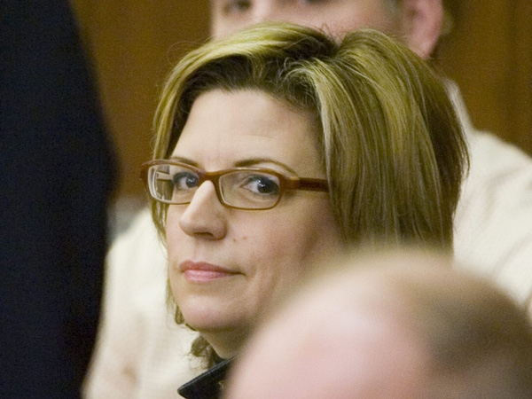 Sandra Buckler looks over towards media that are focused on her instead of the Prime Minister during a photo-op prior to the start of the federal Conservative Caucus meeting, in Ottawa Saturday Jan 26, 2008. (Tom Hanson / THE CANADIAN PRESS)