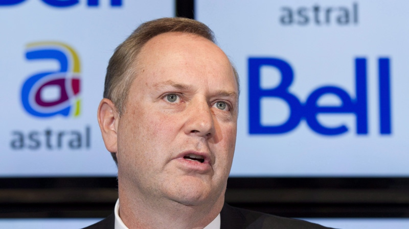 George Cope, BCE president announces the take over Astral Media Inc. by Bell in a deal worth about $3.38 billion Friday, March 16, 2012 in Montreal. (THE CANADIAN PRESS/Paul Chiasson)