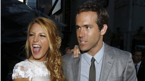 "Ryan Reynolds, right, and Blake Lively pose together at the premiere of ""Green Lantern"" in Los Angeles, Wednesday, June 15, 2011. (AP Photo/Matt Sayles)"
