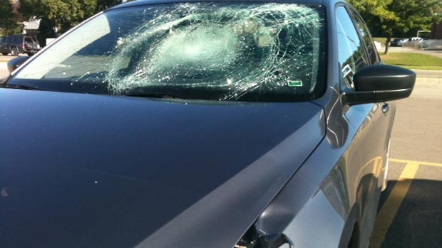 A damaged vehicle is seen after a 12-year-old was struck in Kitchener, Ont. on Monday, Sept. 10, 2012.