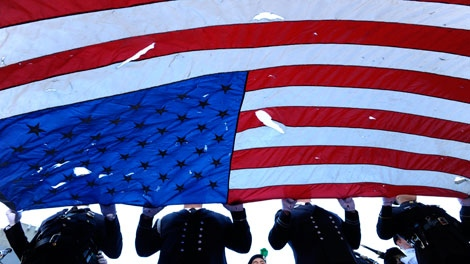 A New York City Honor Guard carries a flag found at ground zero during a memorial service commemorating the ninth anniversary of the Sept. 11 terrorist attacks on the World Trade Center Saturday, Sept. 11, 2010 in New York. (AP Photo/Peter Foley, Pool)